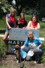 "Three Cadettes from Troop 2257 in Glen Burnie are working on their Silver Award, making dog vests for the SPCA that say "" Adopt Me"" for use with the foster dogs so that they can get attention as they are walked around the neighborhood. The scouts delivered some vests and dog bandannas to the Maryland SPCA today."