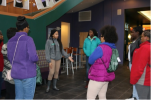 Raven Belford and Revae Boykins (facing camera) give Beyond Bars Girl Scouts a tour of Stevenson University.