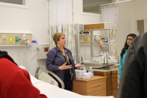An instructor describes features of Notre Dame's nursing simulation lab.