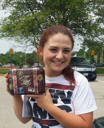 Jamie enjoys a graduation gift that commemorates her 13 years in Girl Scouts Beyond Bars.
